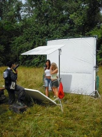 Kacey Barnfield and Angelica Penn standing in the clearing of a forest about to be filmed.