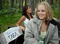 Angelica Penn smiling at the camera with Kacey Barnfield behind her.
