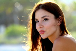 Actress Kacey Barnfield's pretty face looking off camera.