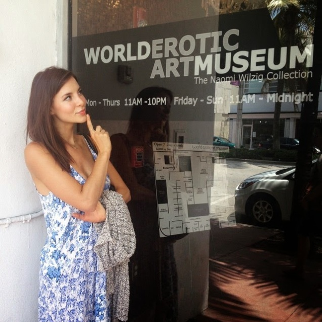 Kacey Barnfield looking playfully thoughtful outside the World Erotic Art Museum.