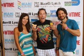 Kacey Barnfield and Michael Worth standing either side of some strange guy.