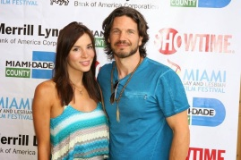 Kacey Barnfield and Michael Worth standing next to each other smiling.