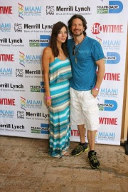 Kacey Barnfield and Michael Worth standing at the Gay & Lesbian film festival.