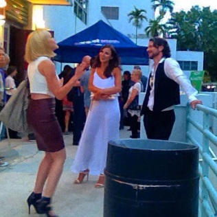 Anya Monzikova telling an in-depth story to a vaguely amused Kacey Barnfield and Michael Worth.