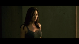 Actress wearing dark vest saying something.