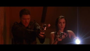 Actress standing next to Wentworth Miller while shining a torch.