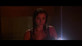 Actress with wet hair looking apprehensive.