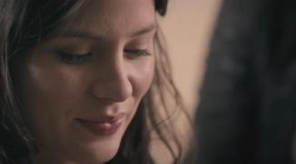 Close-up of actress smiling.