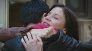 Actress hugging Oliver James.
