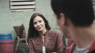 Actress smiling at Oliver James.
