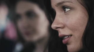 Extreme close-up of actress's profile view.