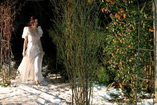 Beautiful woman in long white dress.