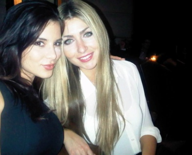 Kacey Barnfield and a hot blonde out at night.