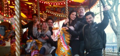 Kacey Barnfield and friends at a fairground carousel.