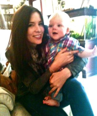 Kacey Barnfield with a cute kid on her lap.