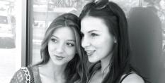 Two gorgeous sisters in a black and white shot.