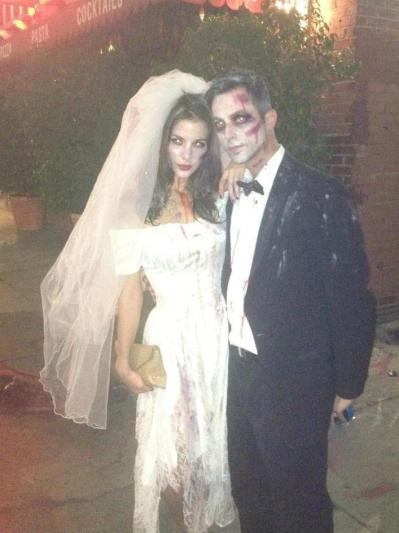 A good-looking couple dressed up for Halloween.