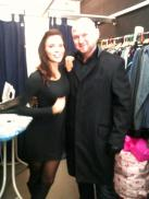 Kacey Barnfield with a smart looking bald guy.