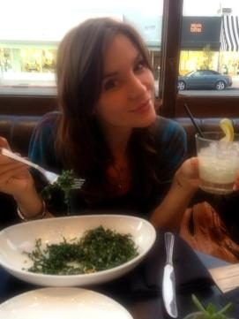 Hot girl showing her unappetizing meal and a drink.