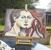 Actress Kacey Barnfield's painted art work of a male and female face meeting in the middle.