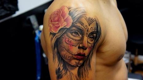 Tattoo of actress on a man's arm.