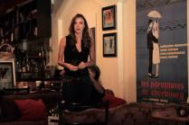 Kacey Barnfield in front of a poster on set of Enchanting the Mortals.