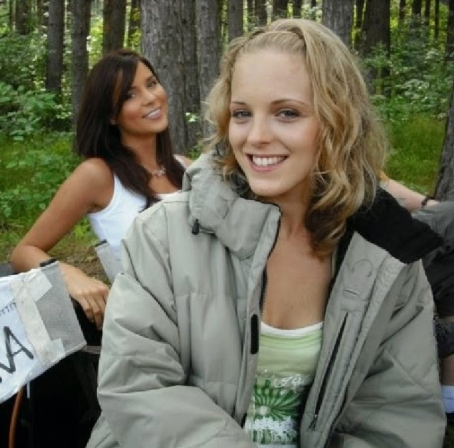Kacey Barnfield and Angelica Penn smiling on the set of Lake Placid 3