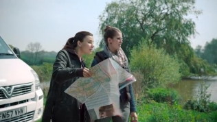 Kacey Barnfield studying a map