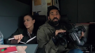 Kacey Barnfield and Ray Panthaki sat in a camper van