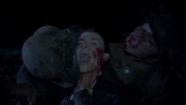 Kacey Clarke being eaten by zombies