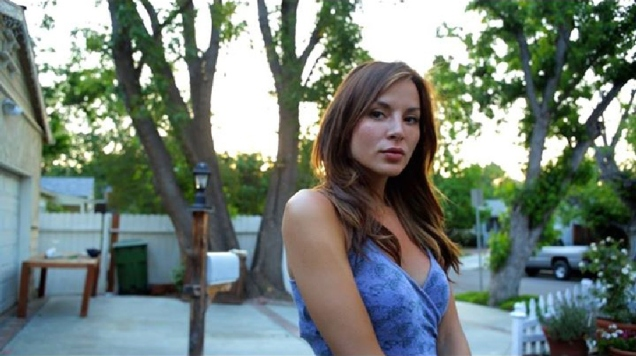 Kacey Barnfield looking at the camera