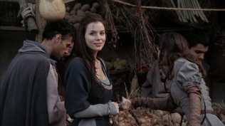 Kacey Barnfield in a medieval village