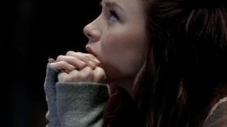 Kacey Barnfield looking up sad