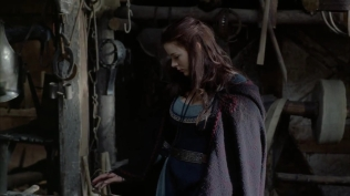 Kacey Barnfield looking around a medieval shop