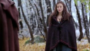 Kacey Barnfield in a long dark shawl