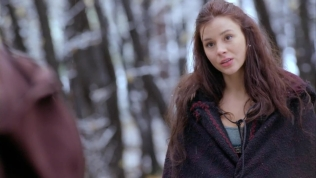 Kacey Barnfield in the snowy woods