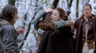 Kacey Barnfield hugging female co-star
