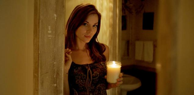 Kacey Clarke holding a candle and looking beautiful