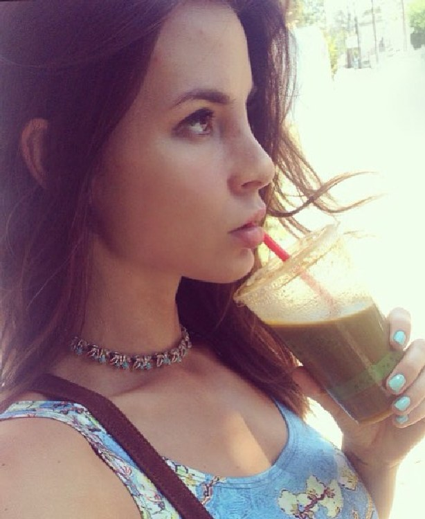 Kacey Barnfield sipping juice in Los Angeles