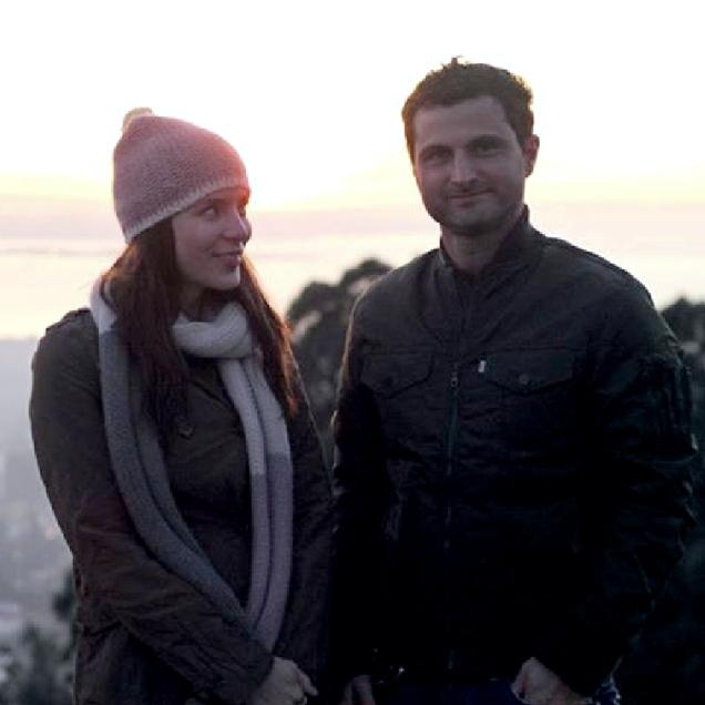 Kacey Barnfield and Raffaello Degruttola standing on a hill