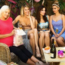 Kacey Barnfield and other actresses sitting backstage