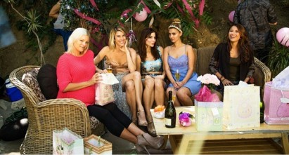 Kacey Barnfield sitting with the rest of the cast