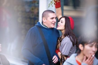 Kacey Barnfield pecking a man on the cheek
