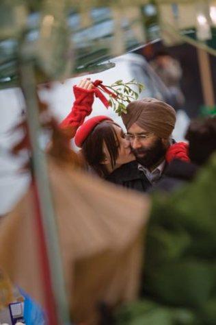 Kacey Barnfield kissing a Sikh man on the cheek