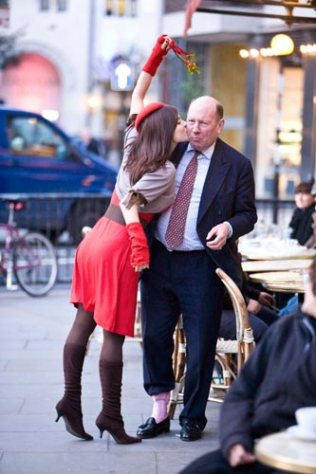 Kacey Barnfield kissing a businessman in London