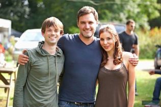 Kacey Barnfield standing with co-star and director