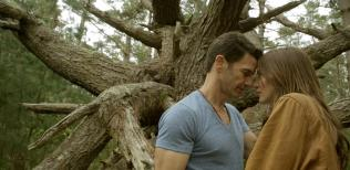 Kacey Barnfield and Michael Worth getting romantic under a tree
