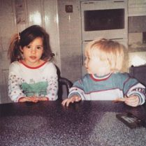 Actress Kacey Barnfield and her brother sat in the kitchen as children