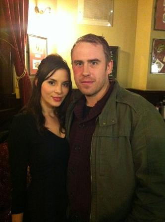 Kacey Barnfield stands in a pub next to another member of the Green Street 3 cast