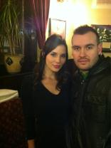 Kacey Barnfield having her photo taken with another member of the cast